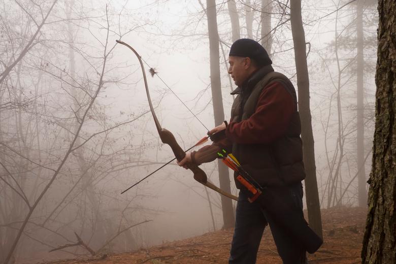 archer preparing to shoot